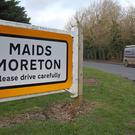 A sign for Maids Moreton, after police launched a murder investigation into the deaths of two elderly residents (Steve Parsons/PA)