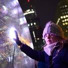 A girl touches the Sonic Light Bubble (Ian West/PA)