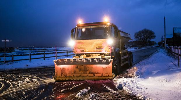 A gritter in snowy conditions near Snowden Hill in Sheffield, South Yorkshire (Danny Lawson?PA)