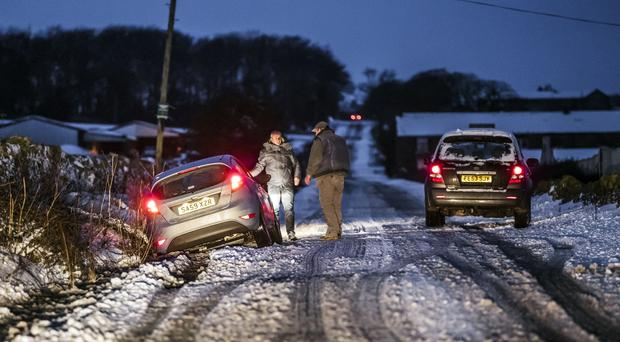 A car in snowy conditions near Snowden Hill in Sheffield, South Yorkshire (Danny Lawson/PA)