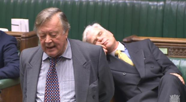 Sir Desmond Swayne MP appearing to sleep as he sits behind former Chancellor Ken Clarke (PA)