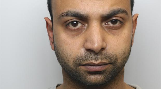 Akshar Ali, who was jailed for life and ordered to serve a minimum of 22 years for the murder of his wife, Sinead Wooding (West Yorkshire Police/PA)