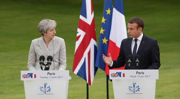 A £44.5million boost to Britain's contribution to border security in France will be announced as Theresa May meets French President Emmanuel Macron (Yui Mok/PA)
