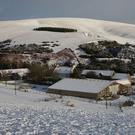 A snow covered farm near Lauder in the Scottish Borders as police are urging motorists to drive with 'extreme caution' amid wintry conditions in Scotland (PA)