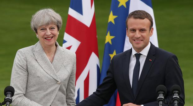 Theresa May is to host summit talks with Emmanuel Macron (Yui Mok/PA)