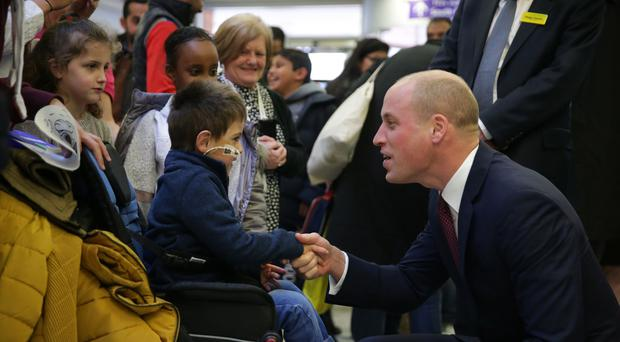 The Duke of Cambridge meets patients during a visit to the Evelina London Children's Hospital in London (Daniel Leal-Olivas/PA)