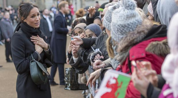 Meghan Markle meets members of the public during a walkabout as she visits Cardiff Castle (Arthur Edwards/The Sun)