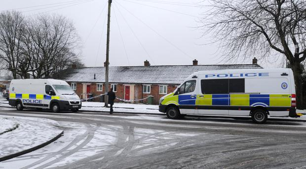 Police at the property in Brownhills, near Walsall (Matthew Cooper/PA)