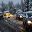Cars struggle in slushy conditions (Andrew Matthews/PA)