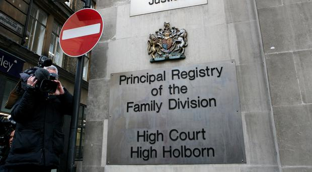 Mr Justice MacDonald is overseeing a trial in the Family Division of the High Court in London (Katie Collins/PA)