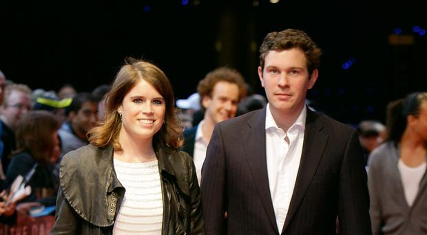 Princess Eugenie and Jack Brooksbank arrive at the premiere of the Batman film, The Dark Knight Rises (PA)