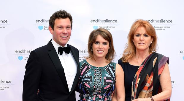 Jack Brooksbank, Princess Eugenie and Eugenie's mother Sarah, Duchess of York (Ian West/PA)