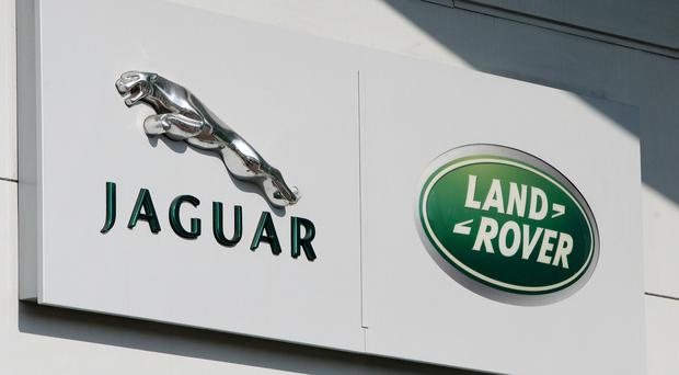 Jaguar Land Rover is adjusting its production schedules (Dave Thompson/PA)