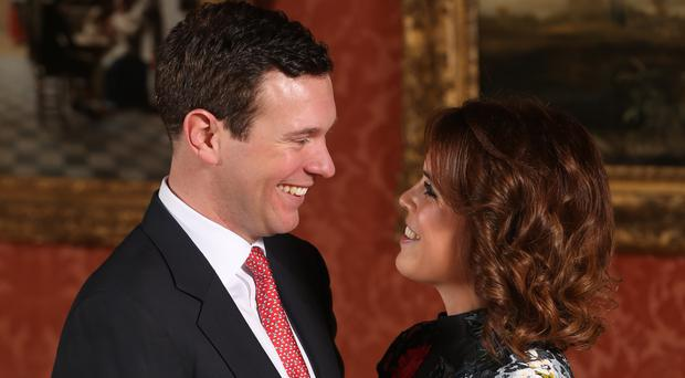 Princess Eugenie poses with Jack Brooksbank in the Picture Gallery at Buckingham Palace to mark their engagement (Jonathan Brady/PA)