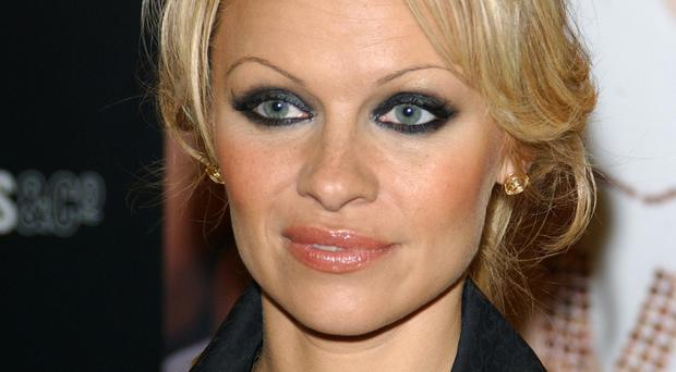 Pamela Anderson says Juian Assange is a 'genius' (Ian West/PA)