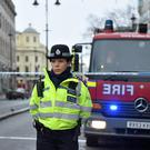 A police officer next to a cordon on the Strand in central London (David Mirzeoff/PA)