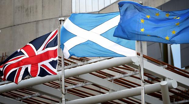 The Union Flag, Saltire and European flag fly outside the Scottish Parliament in Edinburgh (Jane Barlow/PA)