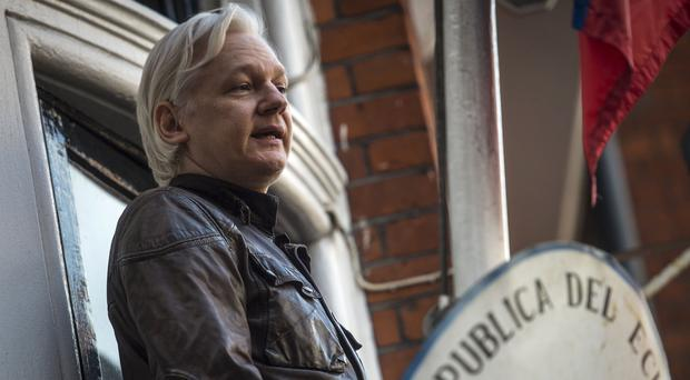 Julian Assange standing on the balcony of the Ecuadorian embassy in west London (Lauren Hurley/PA)