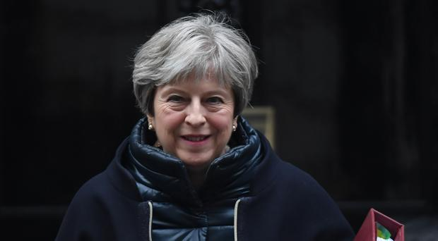 Theresa May will speak in Davos (Stefan Rousseau/PA)