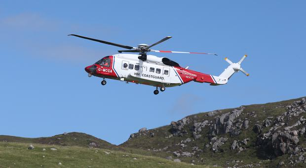 Mountain rescue teams and a coastguard helicopter responded to the emergency (Andrew Milligan/PA)