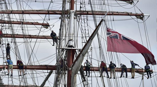 Crew members on a tall ship (Ben Birchall/PA)