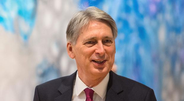 Chancellor Philip Hammond wants a 'middle way' in the Brexit negotiations (Dominic Lipinski/PA)