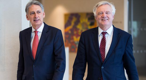 Chancellor Philip Hammond, Brexit Secretary David Davis and Business Secretary Greg Clark have set out their vision of the post-Brexit transition period in an open letter to businesses. (Jack Taylor/PA)