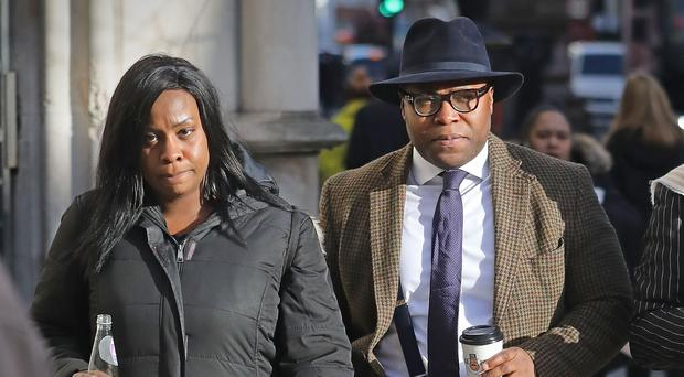 Isaiah Haastrup's mother Takesha Thomas and father Lanre Haastrup outside the High Court in London (Philip Toscano/PA)