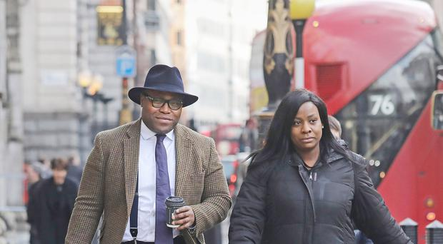 Isaiah Haastrup's father Lanre Haastrup and mother Takesha Thomas arrive at the High Court in London (Philip Toscano/PA)