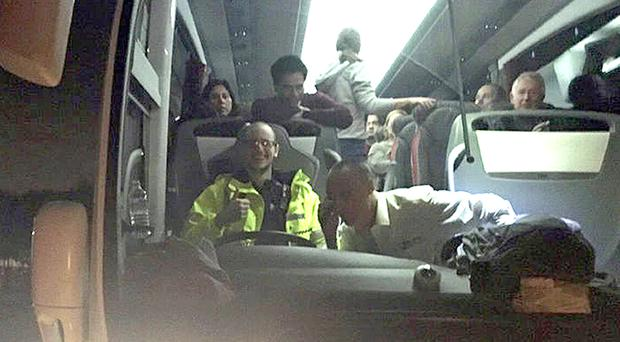 PC Dean Young, who previously worked as a bus driver, as he was left driving a coach full of passengers to safety after their original driver fell ill (Essex Police/PA)