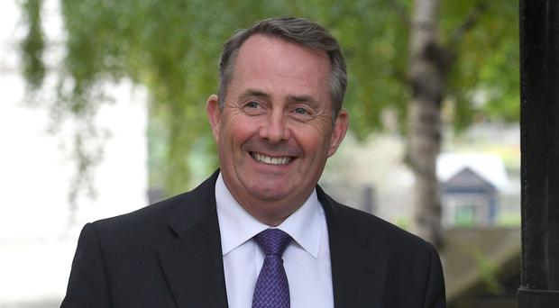 International Trade Secretary Liam Fox seeks to increase trade with Asian economic giant (Stefan Rousseau/PA)