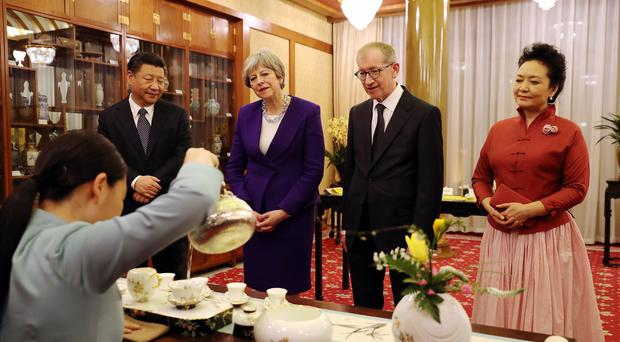 Theresa May and her husband Philip take part in a tea ceremony (Dan Kitwood/PA)