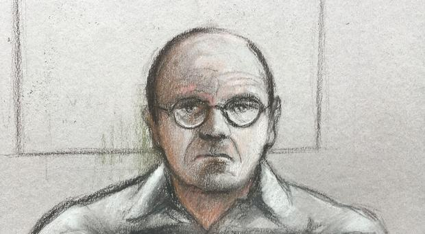 Court artist sketch by Elizabeth Cook of Russell Bishop in custody appearing via video link for a plea hearing at the Old Bailey where he is accused of the murders of two nine-year-old girls in Brighton in 1986. (Elizabeth Cook/PA)