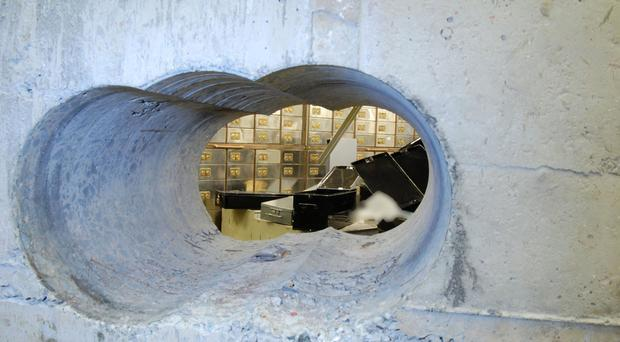 The tunnel leading into the vault at the Hatton Garden Safe Deposit company in London (Metropolitan Police/PA)