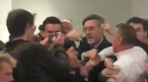 Jacob Rees-Mogg caught in the scuffle (@chloekayex/PA)