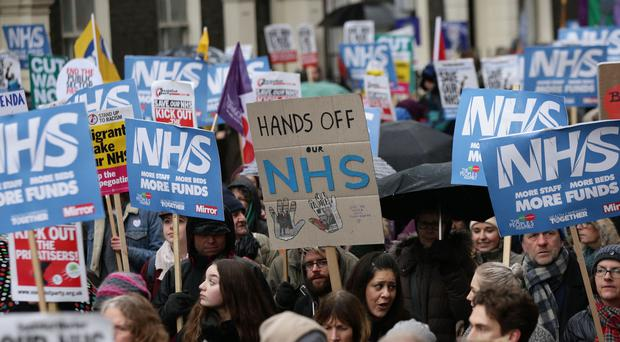 People take part in a march in London in support of the NHS (Yui Mok/PA)