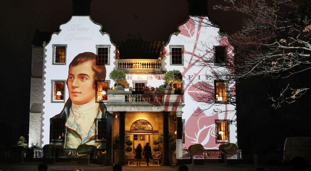 A portrait of Robert Burns was projected on to the front of Prestonfield House on Burns Night (Jane Barlow/PA)