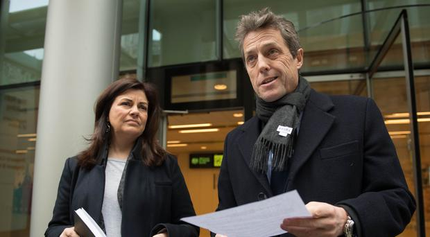 Hugh Grant wins damages from Mirror in phone-hacking case
