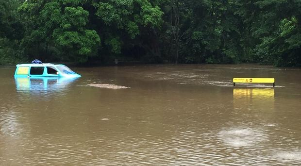 Britons rescued from flooded campervan after parking in crocodile warning area