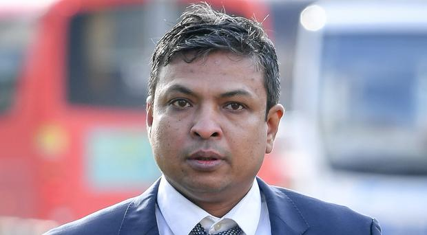Chef Kamrul Islam arriving at Merthyr Tydfil Crown Court where he is accused of attacking a customer by throwing chilli powder into his eyes (Ben Birchall/PA)