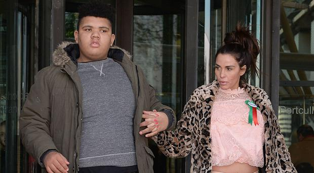 Katie Price and her son Harvey leave Portcullis House in London after giving evidence to the Commons Petitions Committee (Nick Ansell/PA)