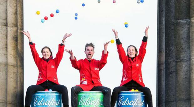 Eilidh Dunnet, James Thomas and Emily Raemakers from the festival team celebrate the launch (Ian Georgeson/Edinburgh International Science Festival/PA)