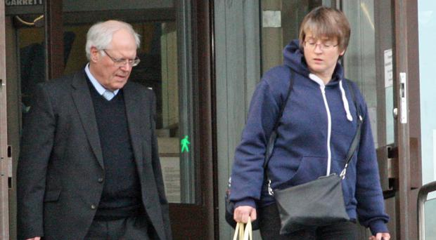 Desmond Hughes and Claire Anderson leave Newport Crown Court (Rod Minchin/PA)