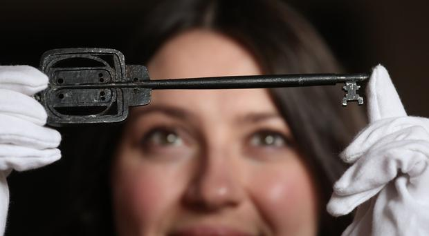 Charlotte Riordhan with the key used to open Glasgow School of Art in 1899 (Andrew Milligan/PA)