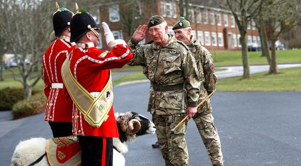 The Prince of Wales meets Private Derby XXII, a Swaledale Ram and the Regimental Mascot during his visit to the 1st Battalion the Mercian Regiment (Peter Nicholls/PA)