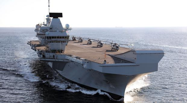 The Royal Navy's new aircraft carrier HMS Queen Elizabeth on its way to Gibraltar (L(Phot) Dave Jenkins/PA)