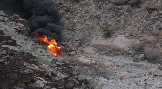 The scene of a helicopter crash which killed three Britons at the Grand Canyon (Teddy Fujimoto/AP)