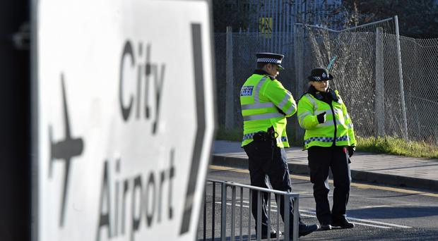 Metropolitan Police officers close to London City Airport which has been closed after the discovery of an unexploded Second World War bomb (Dominic Lipinski/PA)