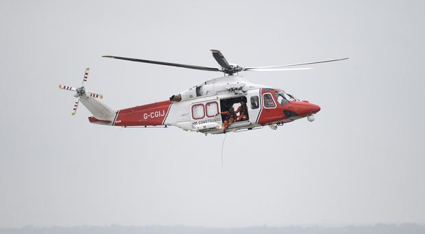 An HM Coastguard Rescue helicopter (Andrew Matthews/PA)