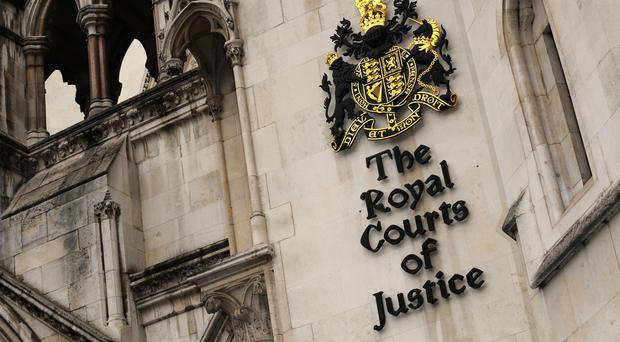 A businessman has failed in a bid to have his estranged wife jailed at a High Court hearing in the Royal Courts of Justice in London (Anthony Devlin/PA)